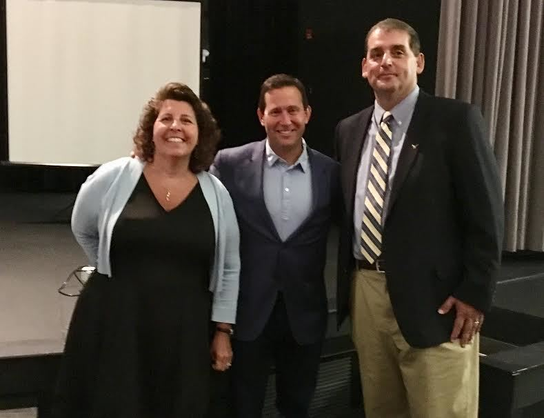 Author, speaker Jon Gordon speaks to BEA staff during opening day event